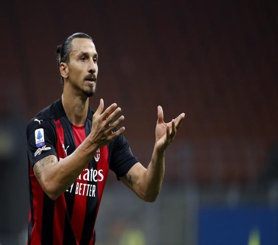 In this Sept. 21, 2020 file photo, AC Milan's Zlatan Ibrahimovic reacts during the Serie A football match against Bologna at the San Siro stadium, in Milan, Italy. (AP Photo/Antonio Calanni).