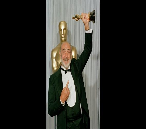 "In this file photo dated April 11, 1988, Sean Connery holds up his best supporting actor Oscar for ""The Untouchables"" at the 60th annual Academy Awards in Los Angeles. Photo: AP Photo/Lennox McLendon, FILE"