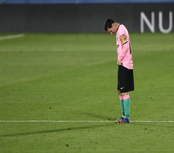 Barcelona's Lionel Messi reacts after Getafe's Jaime Mata scored during their Spanish La Liga football match at the Alfonso Perez stadium in Getafe, Spain, Saturday, Oct. 17, 2020. (AP Photo/Manu Fernandez).