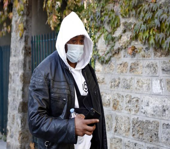 Music producer identified only by his first name, Michel, is pictured on his way to the Inspectorate General of the National Police, known by its French acronym IGPN, in Paris, Thursday, November 26, 2020. French Interior Minister Gerald Darmanin ordered several Paris police officers suspended after the publication of videos showing them beating up a Black man and using tear gas against him with no apparent reason. (AP Photo/Thibault Camus)