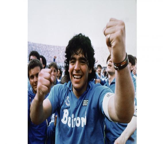 Argentine football superstar Diego Armando Maradona cheers after the Napoli team clinched its first Italian major league title in Naples, Italy, on May 10, 1987. (AP Photo/Massimo Sambucetti, File )