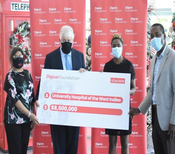 (From left) Digicel Foundation chair Jean Lowrie-Chin, Digicel Group chairman Denis O'Brien, Minister of State in the Ministry of Health and Wellness, Juliet Cuthbert-Flynn and UHWI Chief of Staff Dr Carl Bruce pose with the symbolic cheque at the handover ceremony. (Photos: Marlon Reid)