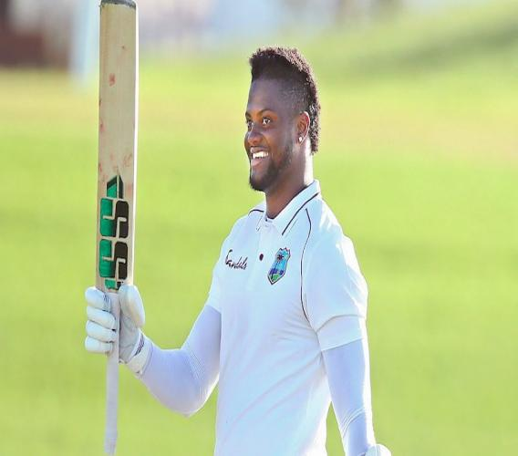 Romario Shepherd raises his bat to celebrate his first maiden first-class hundred at Bay Oval, Mount Maunganui on Thursday. (Photo credit: Photosport New Zealand)