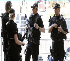 Armed police on guard prior to the start of the Great CityGames at Deansgate, in Manchester, England, Friday May 26, 2017.