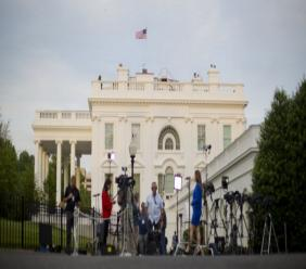 Television Network crews begin their evening news broadcast from the driveway outside the West Wing of the White House in Washington, Wednesday, May 17, 2017. The Justice Department has appointed former FBI Director Robert Mueller as a special counsel to oversee a federal investigation into potential coordination between Russia and the Donald Trump campaign to influence the 2016 presidential election.