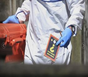 Police forensic investigators search the property of Salmon Abedi in connection with the explosion that took place at the Manchester Arena, in Greater Manchester, England, Tuesday, May 23, 2017.