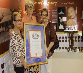 Maxine Marshall (left) and Laverne Daykin (right) congratulate Georgette Ebanks (centre) on receiving the Ira Thompson award named in memory of their late father.