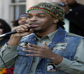 In this Sunday, April 20, 2014, file photo, Jawara McIntosh, son of legendary Reggae icon, Peter Tosh, sings a song as he stands with a large gathering in front of the New Jersey Statehouse in Trenton, N.J. (PHOTO: AP)
