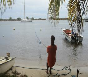 A man pulls in a boat ahead of Hurricane Maria in the Galbas area of Sainte-Anne on the French Caribbean island of Guadeloupe, early Monday, Sept. 18, 2017. (AP Photo)