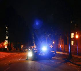 Police block off streets in front of a police station at Georgia Tech where protests happened earlier and at least one police car was burned on Monday, Sept. 18, 2017, in Atlanta.