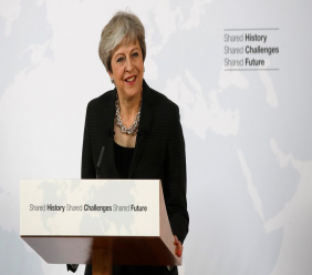 British Prime Minister Theresa May delivers her speech, in Florence, Italy, Friday Sept. 22, 2017. May will try Friday to revive foundering Brexit talks — and unify her fractious government — by proposing a two-year transition after Britain's departure from the European Union in 2019 during which the U.K. would continue to pay into the bloc's coffers.