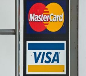 AFP/Archives / NICHOLAS KAMM L'adoption des paiements électroniques de plus en plus répandue, selon le rapport mondial sur les paiements réalisé par le cabinet Capgemini et BNP Paribas