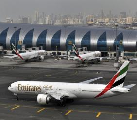 In this Wednesday, March 22, 2017 file photo, an Emirates plane taxis to a gate at Dubai International Airport at Dubai International Airport in Dubai, United Arab Emirates.
