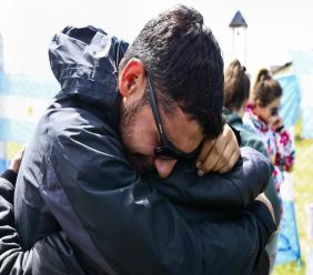Relatives and friends of Alejandro Tagliaprieta, a crew member on the missing ARA San Juan submarine, embrace at the navy base in Mar de Plata, Argentina, Friday, Nov. 24, 2017. The navy says an explosion occurred near the time and place where the sub went missing on Nov. 15. That's led some to give up hope.