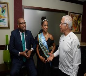 (From left) Delano Seiveright, Senior Advisor/Strategist in the Ministry of Tourism; Solange Sinclair, Miss Jamaica World and Mickey Haughton-James, head of Miss Jamaica World organization in conversation at the Norman Manley International Airport Arrivals VIP lounge following her arrival.