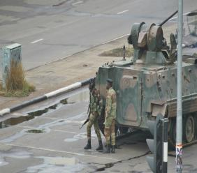 A military tank is seen with armed soldiers on the road leading to President Robert Mugabe's office in Harare, Zimbabwe Wednesday, Nov. 15, 2017.