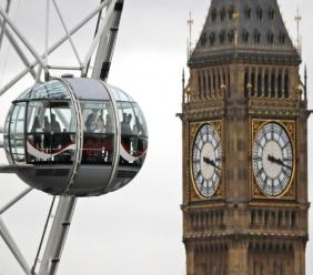 In this file photo dated Tuesday, Feb. 21, 2017, visitors enjoy the view from a pod on the London Eye overlooking Big Ben's clock tower and the Houses of Parliament in London. (AP Photo/Frank Augstein, FILE)