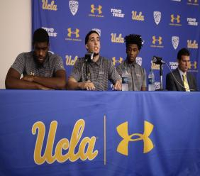 Flanked by Cody Riley, left, and Jalen Hill, third from left, UCLA basketball player LiAngelo Ball reads his statement as head coach Steve Alford listens during a news conference at UCLA Wednesday, November 15, 2017, in Los Angeles. (PHOTO: AP)