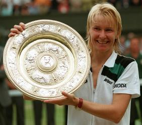 In this July 4, 1998 file photo, Jana Novotna, of the Czech Republic, displays the women's singles trophy after her victory over France's Nathalie Tauziat in the final on Wimbledon's Centre Court. (PHOTO: AP)