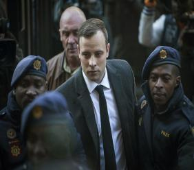 In this July 6, 2016, file photo, Oscar Pistorius, center, arrives at the High Court in Pretoria, South Africa, for a sentencing hearing for the murder of his girlfriend Reeva Steenkamp in his home on Valentine's Day 2013.