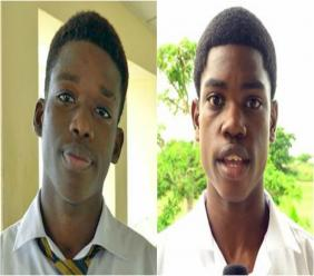 Midfielders Joshua Browne of Christ Church Foundation School and Tyrique Belle of Queen's College.