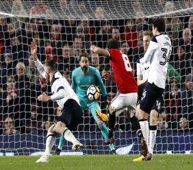 Manchester United's Juan Mata, centre, has a shot at goal during the FA Cup, third round match against Derby County at Old Trafford in Manchester, England, Friday Jan. 5, 2018.