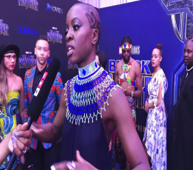 "Danai Gurira speaks as the cast of ""Black Panther"" arrives at the South Africa premiere on Friday, Feb. 16, 2018, in Johannesburg. (AP Photo/Cara Anna)"
