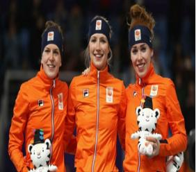 Netherlands skaters (L-R) Ireen Wust, Carlijn Achtereekte and Antoinette de Jong