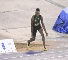 Caymanian Lamar Reid, of Calabar High, reacts after his big jump, which landed his victory in the Boys' Class 2 long jump final at the 2018 ISSAGraceKennedy Boys and Girls' Athletics Championships at the National Stadium on Wednesday. Reid cut the sand with a mark of 7.23 metres to lead home a 1-2 finish for his school. (PHOTO: Marlon Reid).