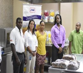 Participants eagerly await the final results at the Jamaica Flour Mills King Of Buns Easter Bun Competition on Tuesday. (PHOTOS: Marlon Reid)