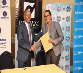 DBJ's Managing Director Milverton Reynolds signing the official sponsorship agreement with Platinum Sponsor PANJAM Investments VP New Business Development and Strategy, Joanna Banks.
