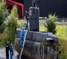 (Image: AP: File photo of police on Peter Madsen's submarine in Copenhagen on 13 August 2017)