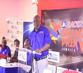 President of Racers Track Club, Glen Mills makes the main address at the Press Conference to launch the third staging of the JN-Racers Grand Prix at the Jamaicsaa Pegasus Hotel on Thursday. (PHOTO: Marlon Reid).