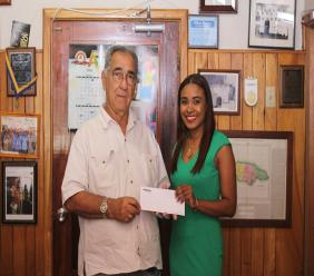 """PROVEN Wealth Portfolio Advisor Christine Benjamin smiles with Custos of Clarendon William """"Billy"""" Shagoury at the recent cheque handover supporting the initiatives for the Clarendon Crime Prevention."""
