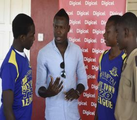 Jamaica and West Indies all rounder Rovman Powell (centre) mentors students during the opening day of the Digicel Caribbean Premier League (CPL) Youth Cricket Serieson Wednesday at the Boys' Town Development Centre. (PHOTO: Marlon Reid).