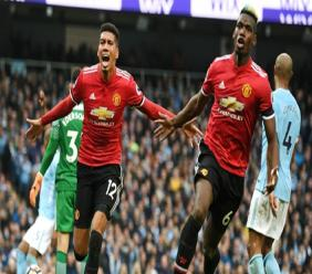 Chris Smalling (L) and Paul Pogba celebrate against Manchester City.