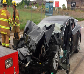 In this Friday, May 11, 2018, file photo released by the South Jordan Police Department shows a traffic collision involving a Tesla Model S sedan with a Fire Department mechanic truck stopped at a red light in South Jordan, Utah. The Tesla that crashed while in Autopilot mode accelerated in the seconds before it smashed into the stopped firetruck, according to a police report.