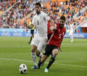 Uruguay's Luis Suarez, left, challenges for the ball with Egypt's Sam Morsy during the group A match at the 2018 football World Cup in the Yekaterinburg Arena in Yekaterinburg, Russia, Friday, June 15, 2018.