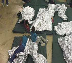 (Image: AP: People who've been taken into custody related to cases of illegal entry into the US rest in one of the cages at a facility in McAllen, Texas, on 17 June 2018)