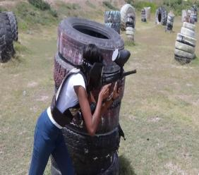 Shanique plays paintball at Dacosta Farm.