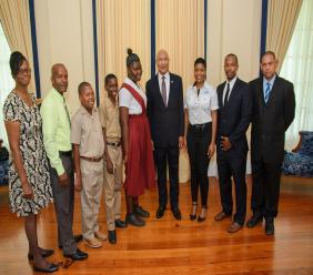 (L-R) Marva McKnight, Teacher, Maggotty High School; Kevin Seaton, Teacher, Aberdeen High School; Nathaniel Morrison, Student, Black River High School; Willando Blair, Student, Aberdeen High School; Alexi Campbell, Student, Maggotty High School; Sir Patrick Allen, Governor General; Donnique Mullings, Administrative Assistant, M&M Jamaica Ltd.; Richard Mullings, Director, M&M Jamaica Ltd. and Cecil Ramsamugh, Teacher, Black River High School