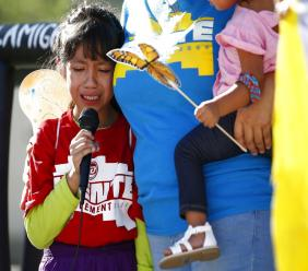 Akemi Vargas, 8, cries as she talks about being separated from her father during an immigration family separation protest in front of the Sandra Day O'Connor U.S. District Court building in Phoenix.  (AP Photo/Ross D. Franklin, File)