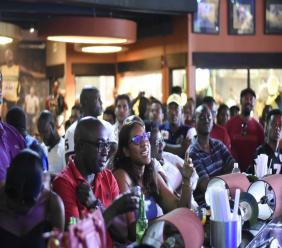 Football fans watch the World Cup finals between France and Croatia at Usain Bolt's Tracks and Records in Marketplace, St Andrew. (PHOTOS: Marlon Reid)