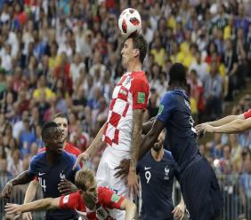 Croatia's Mario Mandzukic, center, scores an own goal during the final match against France at the 2018 football World Cup in the Luzhniki Stadium in Moscow, Russia, Sunday, July 15, 2018. (AP Photo/Matthias Schrader).