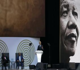 US President Barack Obama, at podium, delivers his speech at the 16th Annual Nelson Mandela Lecture at the Wanderers Stadium in Johannesburg, South Africa, Tuesday. (AP Photo/Themba Hadebe)