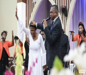 Marion Hall with Bishop Everton Thomas during the ordination service.