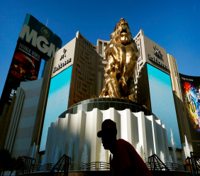 In this Aug. 3, 2015, file photo, a man rides his bike past the MGM Grand hotel and casino in Las Vegas. The operator of the Mandalay Bay casino-resort from which a gunman carried out the largest mass shooting in U.S. history has filed federal lawsuits against hundreds of victims. (AP Photo/John Locher, File)