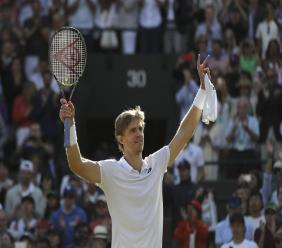 Kevin Anderson of South Africa celebrates winning his men's quarterfinals match against Switzerland's Roger Federer, at the Wimbledon Tennis Championships, in London, Wednesday July 11, 2018. (AP Photo/Ben Curtis).
