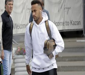 Neymar heading home from the World Cup.