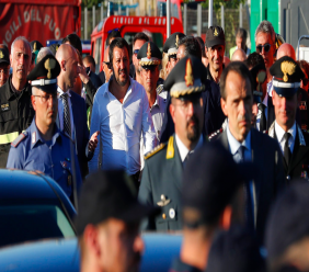 Interior Minister Matteo Salvini, center, arrives at the site where the Morandi highway bridge collapsed, in Genoa, northern Italy, Wednesday, Aug. 15, 2018. A bridge on a main highway linking Italy with France collapsed in the Italian port city of Genoa during a sudden, violent storm, sending vehicles plunging 90 meters (nearly 300 feet) into a heap of rubble below. (AP Photo/Antonio Calanni)